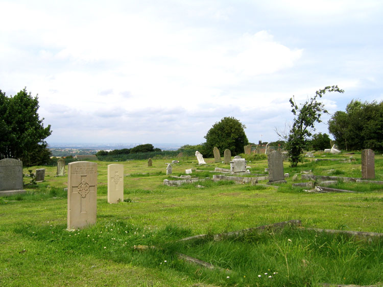 A view of Brotton Church Cemetery, looking towards Middlesbrough, with the headstones for Privates Clarke and Marshall in the foreground.