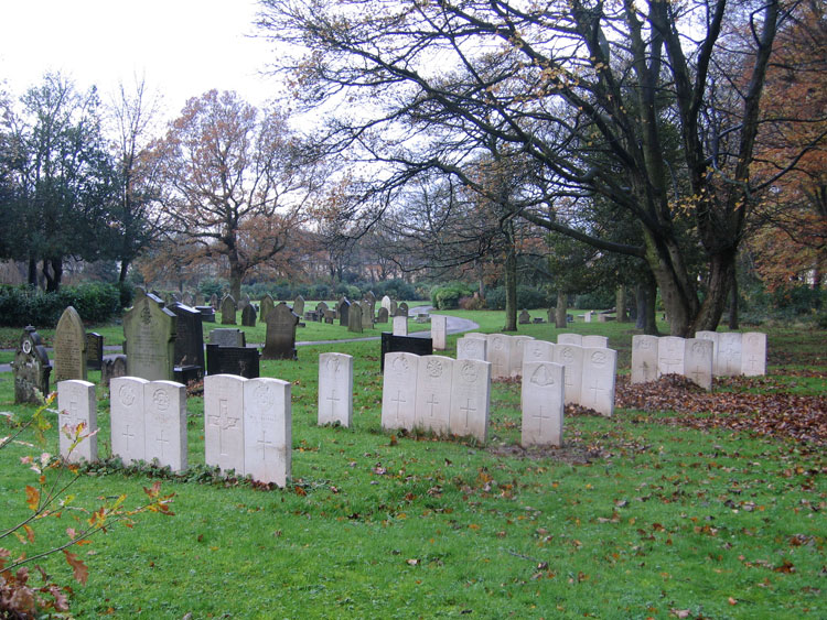 A section of Preston (New Hall lane) Cemetery, - with Private Hall's grave among the three at the rear (right).