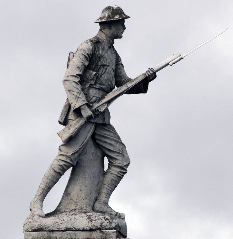 The sculpture of a First World War infantryman on top of the Tow Law War Memorial (August 2011)